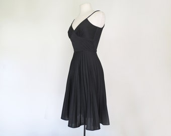 LA DOLCE VITA // black spaghetti strap 1970s dress with pleated skirt xS / S / M
