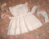 Ready to Ship Pinafore Dress in white broadcloth with eyelet flutter sleeves.  Size 12 months - 1T.