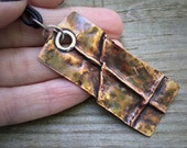 Substantial fold formed copper and greek leather necklace