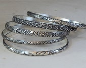 Sterling Silver Stackable Bangle Set Featuring Floral Patterns and Antiqued Patina and Boho Flair by Nici Laskin