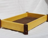 Valet box or tray in yellowheart and walnut lined with leather