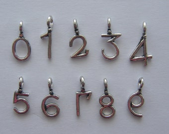 10 Number charms 19 x 8 and 20 x 10mm antique silver tone