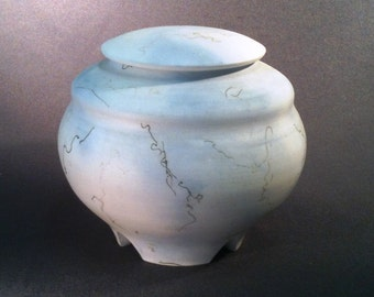 blue horsehair lidded with carved foot