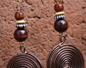 Afrocentric style dangle, Spiral earrings with bone beads, Swarovski crystals