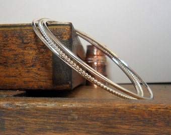 Silver Stacking Bangles, One Beaded Silver Bangle and Two plain Silver Bangles