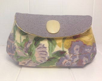 Clutch purse with wrist strap. Handmade with sustainable upcycled materials