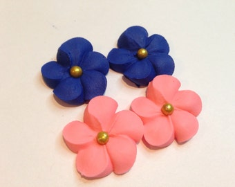 100 royal icing flowers blue and peach