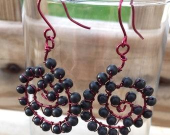 Red swirly earrings