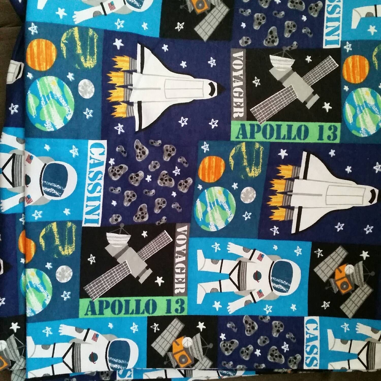 Kids flannel fabric space astronaut planets glow in the dark for Space themed fleece fabric