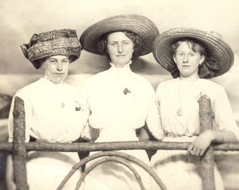 Three Women In White Cotton Dress With HUGE EDWARDIAN HATS Standing Behind Fence Photo Postcard Circa 1910s