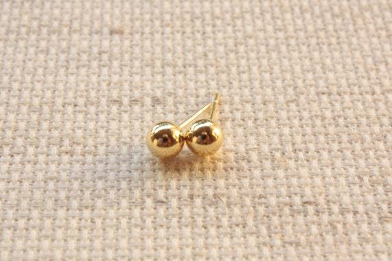 14 karat gold plated silver stud earrings by