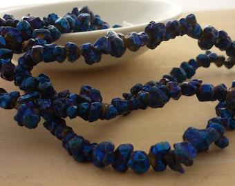 Metallic blue coated quartz nugget beads 4-6mm 1/2 strand