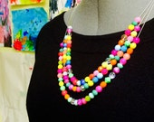 Beautiful and vibrant triple strand beaded statement necklace. Neon bright colored beads add sparkle to your summer outfits.
