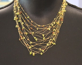 Gold twisted strand necklace with beads