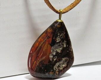 Elegant pendant of vintage natural genuine cognac colour Baltic amber.