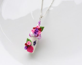 Fairy house necklace in pink and purple colours handmade from polymer clay