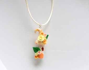 Fairy house necklace in peach and yellow handmade from polymer clay