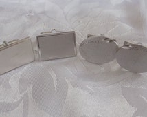 Two pairs of Anson cuff links, one marked Sterling, men's suit and tie accessories