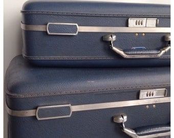 Set of Deep Blue American Tourister Suitcases