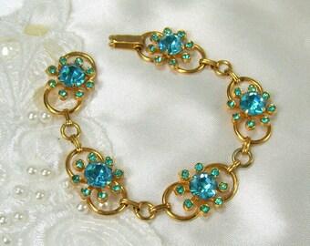 Vintage Coro Bracelet Star Burst Link Blue Rhinestones Gold Tone Designer Signed