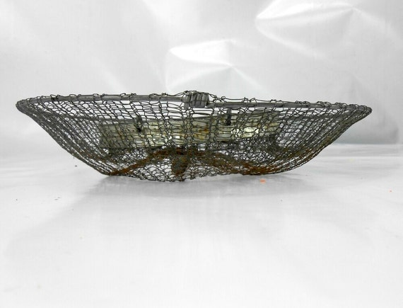 Old wire mesh live bait basket fish boat