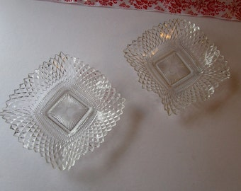 Vintage set of two, clear, 'Carnival' glass square candy dishes.