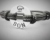 "Boys Bracelet stamped with a zuni bear at the top and ""SON"" at the bottom or Pick your own 3 initials, New! adjustable paraline cord"