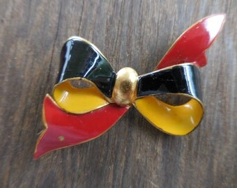 Vintage Gold Tone Enamel Yellow/Black/Red Bow Pin/Brooch Metal 1940s to 1950s