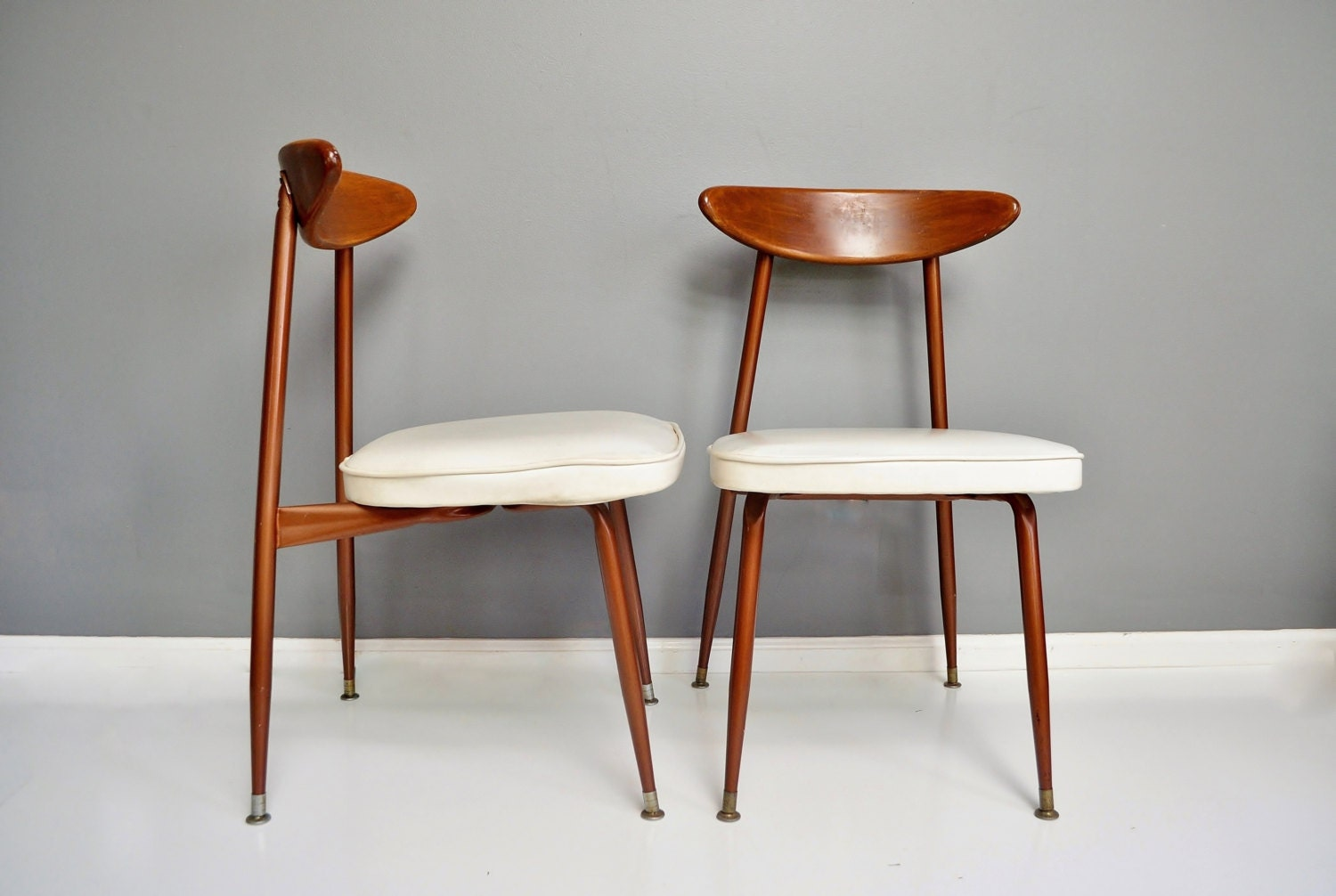 pair of mid century wood and metal dining chairs. Black Bedroom Furniture Sets. Home Design Ideas