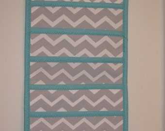 Gorgeous grey chevron accented with teal!