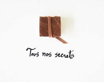 Book Art - Tous nos secrets (All our secrets) - original, light brown taupe leather, white, beige, elegant, paper, script, French text, 8x10