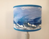 Handcrafted drum lampshade, wet felted, depicting a seascape.