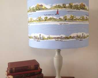 Landscape drum lampshade with stitched detail.