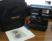 Polaroid 600 Business Edition 2 with neck strap, instructions and Polaroid bag. Fully tested with film. Like NEW