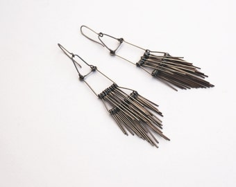 Long silver dangle earrings made of silver stainless steel