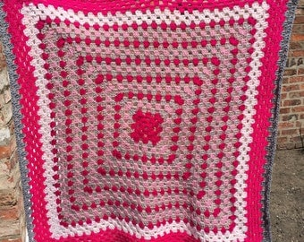 Beautiful crocheted baby blanket in pinks and greys