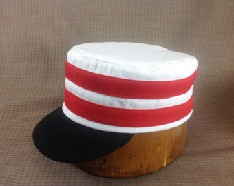 Custom made Vintage base ball boxcap. White heavy twill cotton cap with two red cotton bands, black visor, any size available.