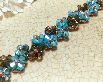 The Zoe- Turquoise and Smoked Topaz Swarovski Crystal and Copper Seed Bead Flower Tennis Bracelet