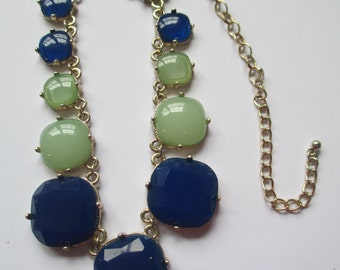 Vintage art deco silver toned  chain necklace with separate blue and green settings no markings