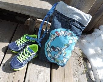 ecofriendly drawstring gym bag for kids made with upcycled pants and a tshirt with skull design