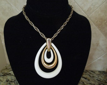 Vintage Trifari Necklace with Pendant.  Long Steel Chain, Gold Tone and Hard Plastic Signed Pendant.