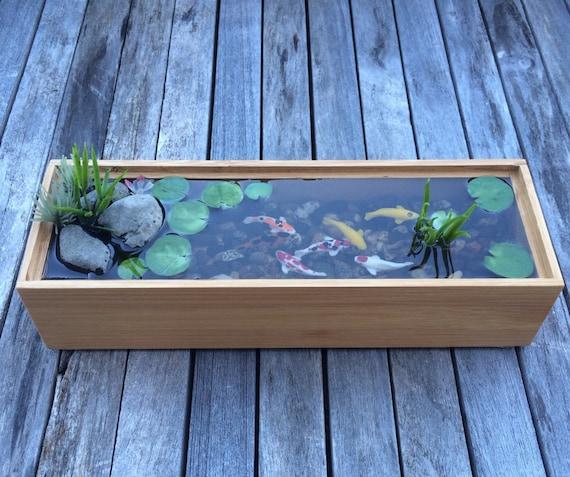 Beautiful bamboo miniature koi pond for Miniature fish pond