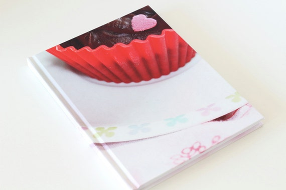 Notebook with photograph of cupcake on the front cover