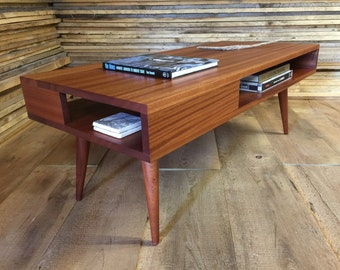 Thin Man mid century modern coffee table with storage, featuring sapele mahogany with tapered wood legs.