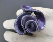 Metallic purple swirly ring sewn on black ELASTIC BAND/ black polymer clay painted with nail polish and pearl powder