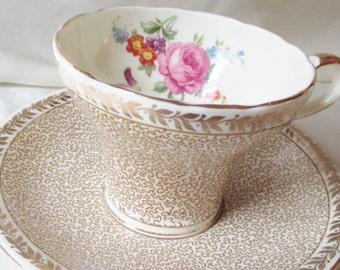 1950s Aynsley Bone China Tea Cup/Saucer.Tan Mesh with Gold Leaf Rim Border,Gold Trim, Interior Floral Transfer.