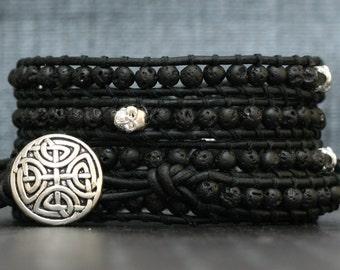 wrap bracelet- silver skulls and black lava on matte black leather