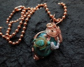 Turtles and turquoise wire wrapped hand made necklace in copper