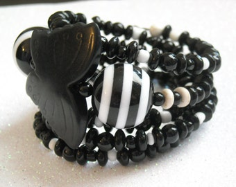 Black Magnesite Stone Butterfly, with Black and White Beaded Memory Wire Bracelet