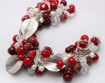 Glass lampwork bracelet with cranberries and ice. Red and silver color.